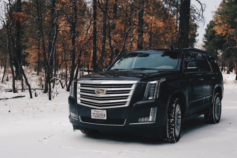 cadillac escalade snow winter road tour trip usa