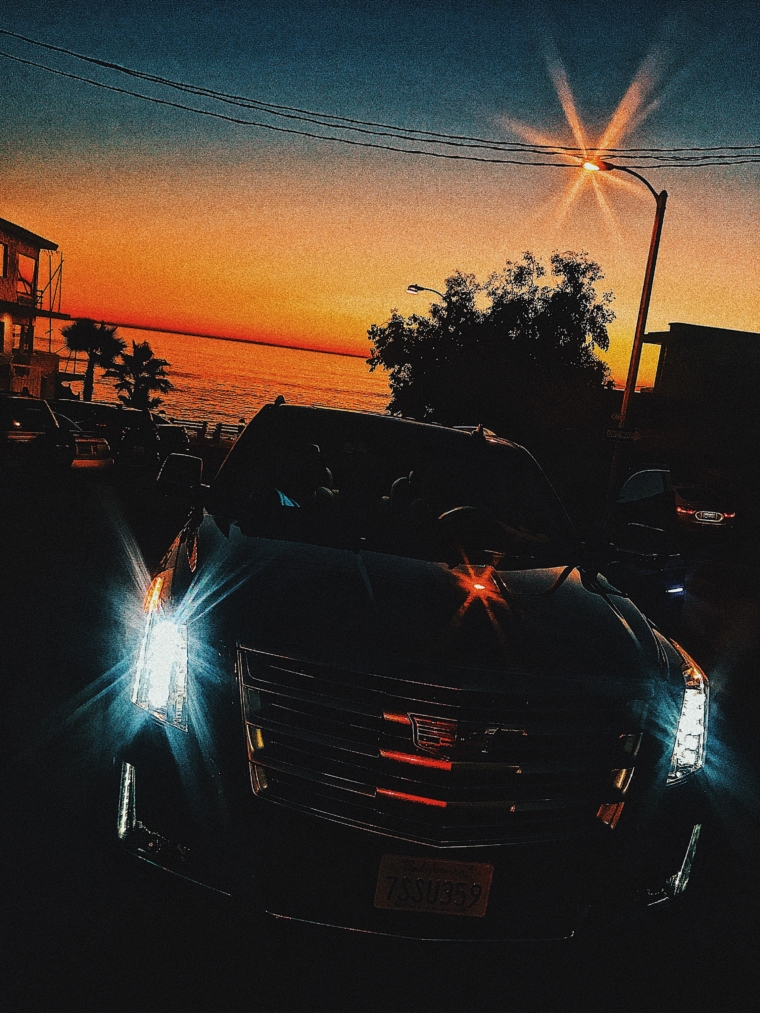 cadillac escalade laguna beach sun set
