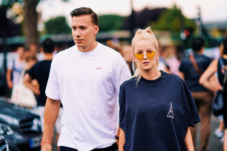 streetstyle before vetements show paris fashion week ss19 spring sommer 2019 couple wearing vetements