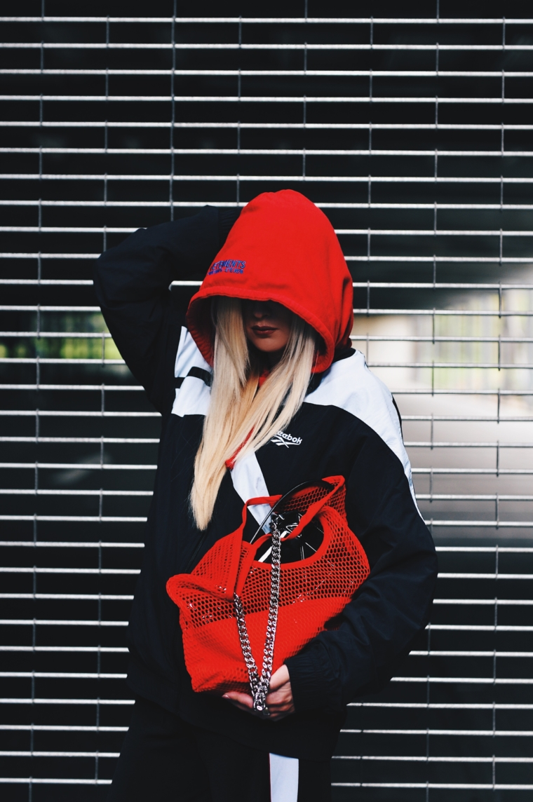 red limited edition exclusiv vetements hoodie in red reebok jacket & net bag vetements streetstyle