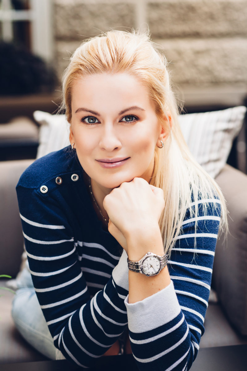 sporty style, blue white striped shirt, blonde, silver watch